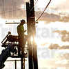Cable guy:  Chris Deaton does maintenance on a Time Warner Cable line on Poplar Street late in the day Tuesday.