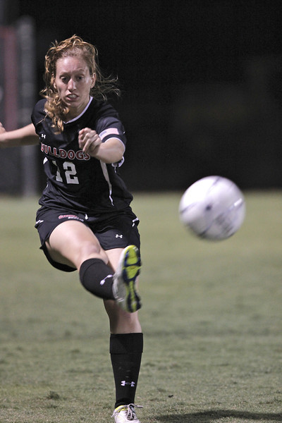 Shaylyn Poppe (12) kicks the ball.