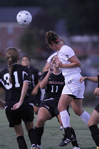 Megan Tremblay (11) and Addison Abee (31) stand their ground while a Jacksonville State player heads the ball.
