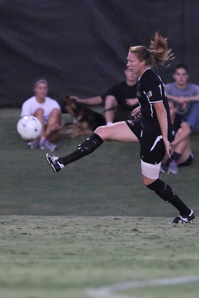 Stephanie Benshoof (16) kicks the ball.