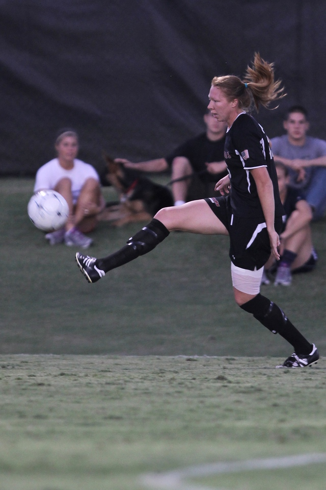 Stephanie Benshoof (16) kicks the ball.