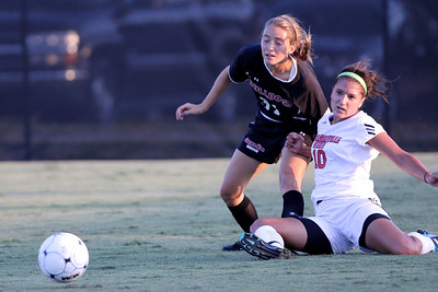Addison Abee (31) fights against an opposing player for the ball.