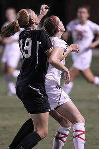 Jessica Casper (19) watches carefully as she takes on an opposing Jacksonville State player for control of a throw in.