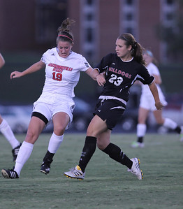 Katie Soles (23) keeps her eyes on the movement of the ball while a Jacksonville State player tries to distract her.