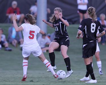 Shaylyn Poppe (12) fights for the ball.