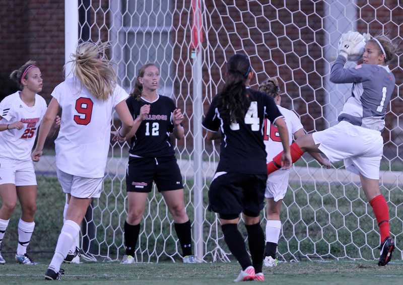 Goalkeeper, Erika Lenns, catches the ball and keeps Jacksonville State from scoring a goal after a corner kick.