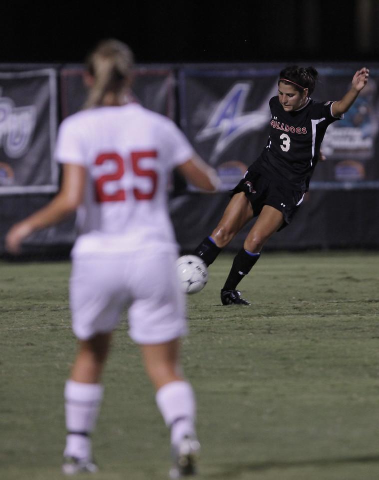 Taylor Napoli (3) kicks the ball.