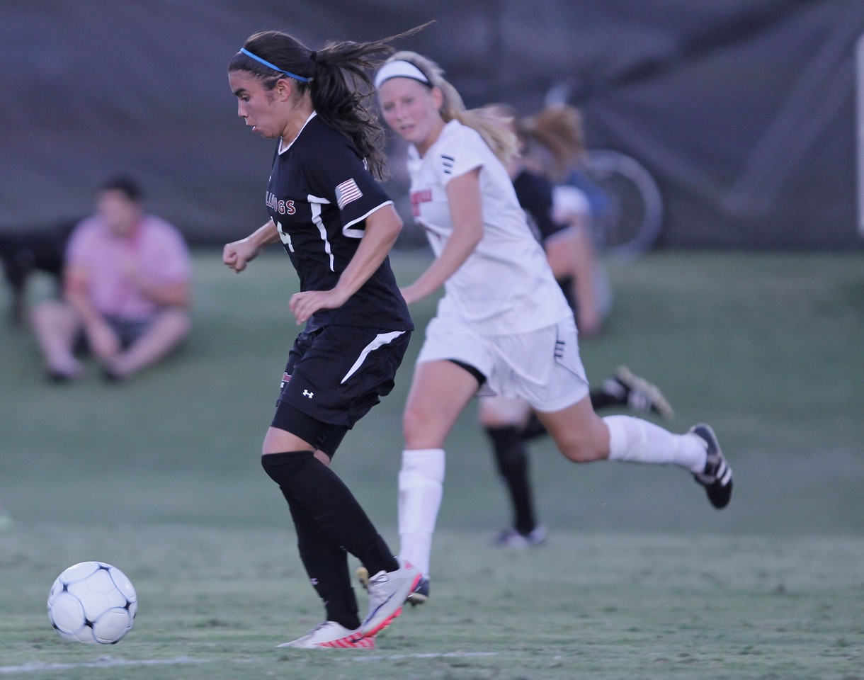 Karyn Latorre (14) pushes the ball up the field.