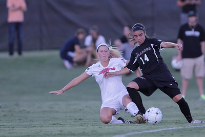 Karyn Latorre (14) shuts down an opposing player who trys to take the ball from her.