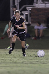 Addison Abee (31) dribbles the ball up the field.