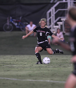 Tina Frost (6) kicks the ball up the field.