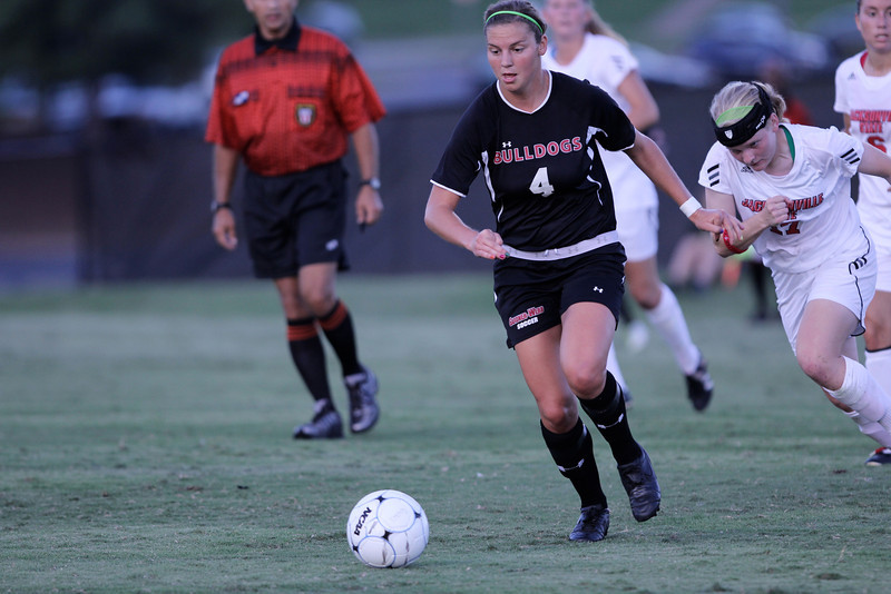 Megan Reimer (4) pushes towards the goal ahead of an opposing player.