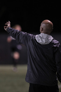 Head Coach, Kevin Mounce, coaches his team during their game.