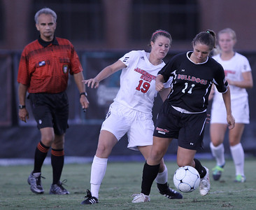 Megan Tremblay (11) remains calm and in control of the ball despite an opposing player trying to steal the ball from her.