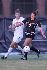Dawn Rollyson (7) fends off an opposing player as she works towards the goal.