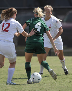 Shaylyn Poppe (12) and Megan Frost (9) double team a Stetson player.