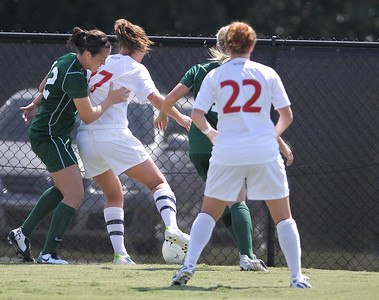 Meagan Reynolds (17) fights to maintain possession of the ball against two Stetson players.