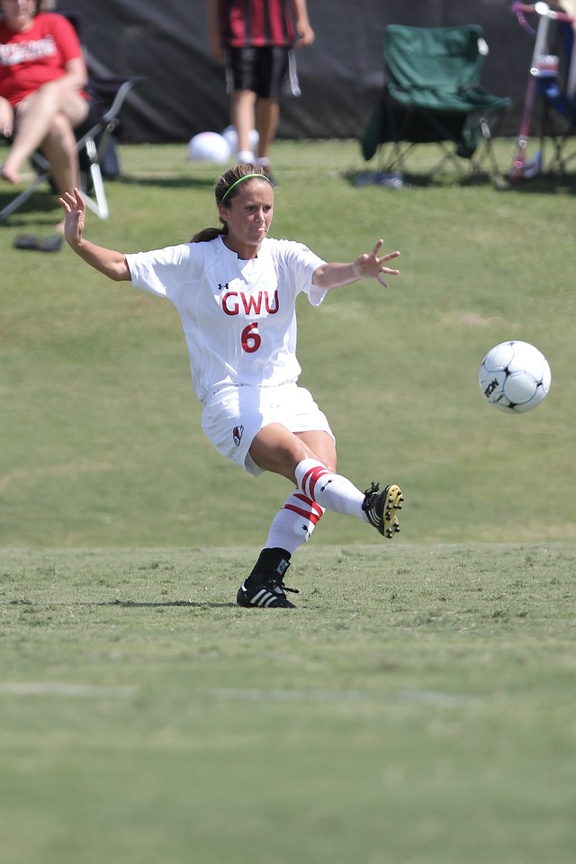 Tina Frost (6) kicks the ball.
