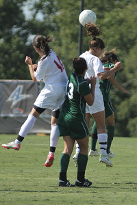Karyn Latorre (14) and Meagan Reynolds (17) jump to head the ball on a throw in.
