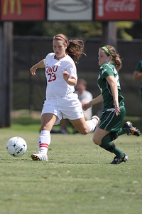 Katie Soles (23) defends her half of the field by kicking the ball towards the other side of the field.