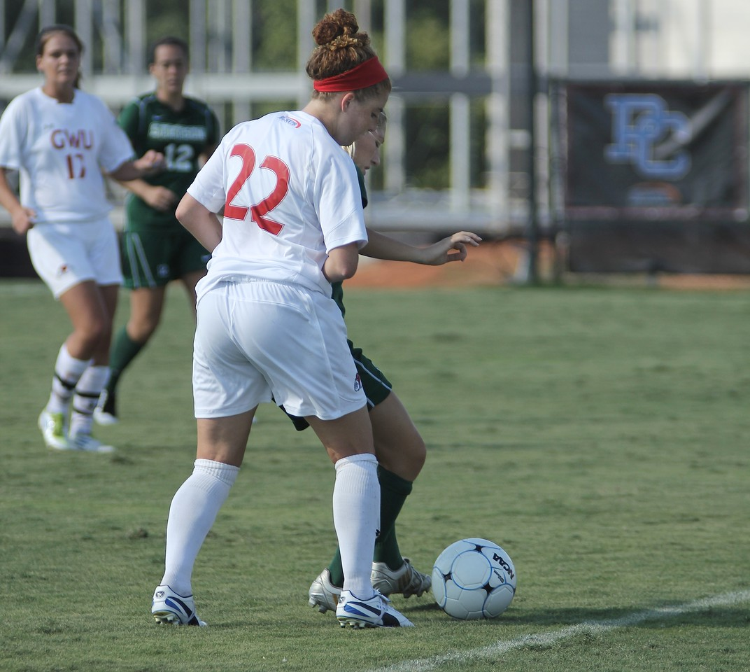 Sarah Morabito (22) fights for possession and to keep the ball in bounds.