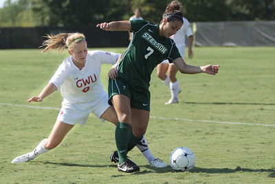 Megan Curan (8) fights for the ball.