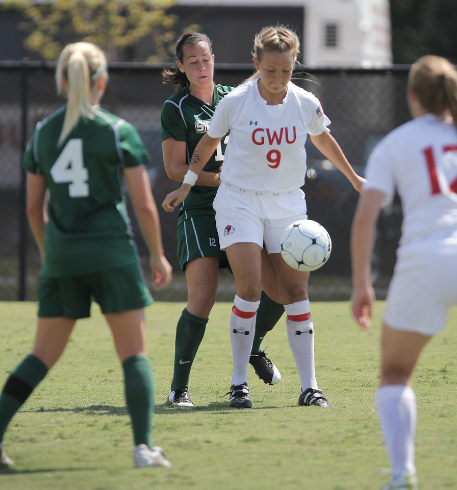 Megan Frost (9) traps the ball on a throw in.