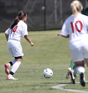 Karyn Latorre (14) looks to her teammates to make a pass.