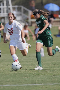 Katie Soles (23) keeps close to an opposing player to keep her from scoring.