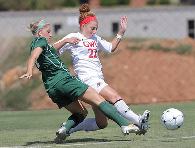 Sarah Morabito (22) fights against an opposing player for possession of the ball.
