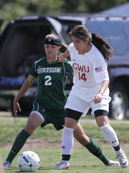 Karyn Latorre (14) fights for the ball.