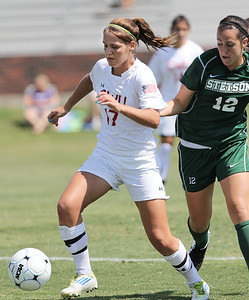 Meagan Reynolds (17) dribbles the ball towards the goal.