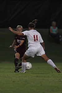 Megan Tremblay (11) kicks the ball away from an opposing player.