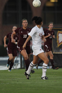 Taylor Napoli (3) turns around as the ball and Winthrop players come towards her.