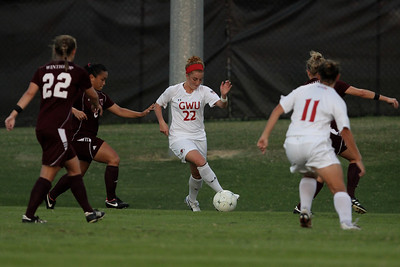 Sarah Morabito (22) keeps calm and maintains control of the ball despite three Winthrop players surrounding her.