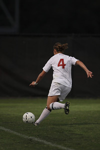 Megan Reimer (4) dribbles the ball down the field.