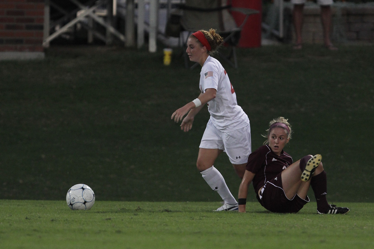 Sarah Morabito (22) after obtaining possession of the ball, looks for a pass up the field.