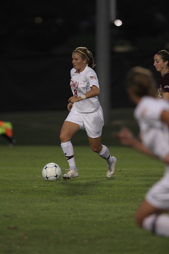 Megan Curan (8) dribbles the ball up the field.
