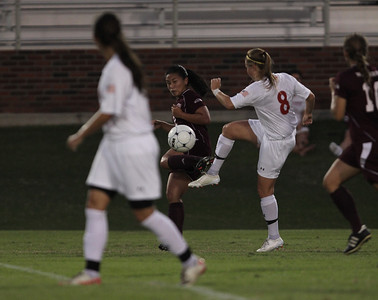 Megan Curan (8) kicks the ball.