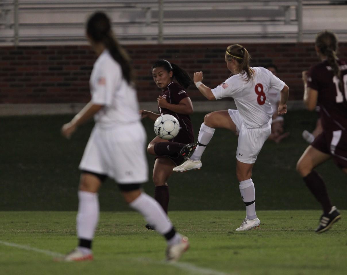 Megan Curan (8) kicks the ball.
