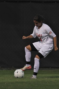 Karyn Latorre (14) obtains control of the ball.