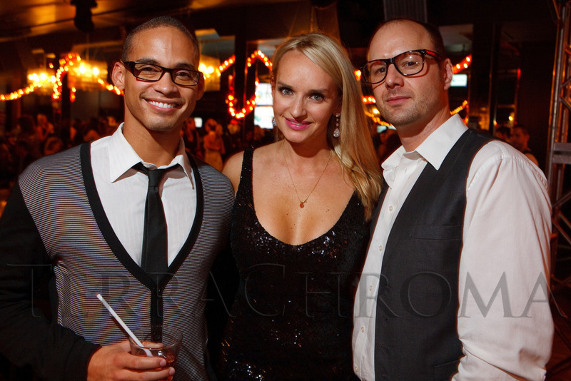 "(Denver, Colorado, Sept. 17, 2011)<br /> Nate Carroll, Paulina Szafranski, and Jim Guttau.  The Eighth Annual Volunteers of America Fashion Show, ""The Sweet Life,"" at Suite Two Hundred in Denver, Colorado, on Saturday, Sept. 17, 2011.<br /> STEVE PETERSON"