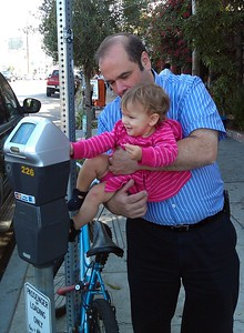 Shai explores a parking meter with Grandpa Gary