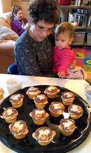 Grandma Hope and Shai admire the monkey cupcakes