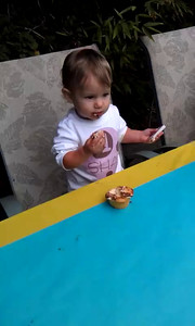 About five minutes of Shai eating a cupcake