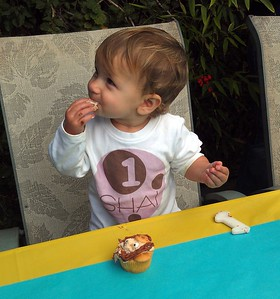 Shai enjoys her 1st birthday cupcake