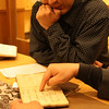Shi Lei viewing a rare book from Kaifeng Synagogue