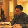 Delores Goldfinger and Shi Lei view a Kaifeng book