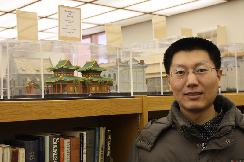 Shi Lei viewing the model of the Kaifeng Synagogue at Temple Beth El in Bloomfield Hills, MI