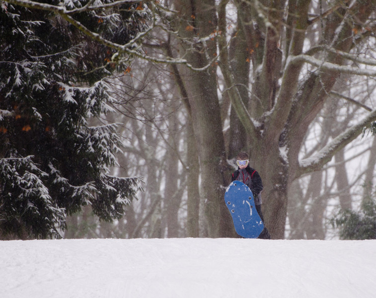 The intrepid sledder eyes his hill.